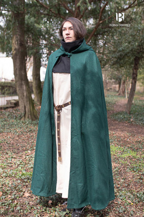 Woman who is wearing the hooded cloak hibernus in green. It nearly touches the ground, as it is very long.